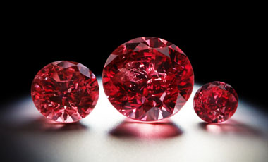 "An undated handout photo released by Rio Tinto and received on May 17, 2013 shows three red diamonds, including the biggest 'red' diamond (C) produced by mining giant Rio Tinto's Australian mine, and which is up for sale amid an ""explosion"" in demand from Asia for the pink-hued stones, in Sydney on May 17, 2013. The Argyle Phoenix, a 1.56 carat round brillant gem, is one of three red diamonds on offer at the annual Argyle Pink Diamonds Tender -- the first time in the 30-year history of exclusive sale that it has included three red stones. AFP PHOTO / RIO TINTO ----EDITORS NOTE ----RESTRICTED TO EDITORIAL USE MANDATORY CREDIT "" AFP PHOTO / RIO TINTO"" NO MARKETING NO ADVERTISING CAMPAIGNS - DISTRIBUTED AS A SERVICE TO CLIENTS AUSTRALIA-BRITAIN-RESOURCES-RIO TINTO-DIAMOND"